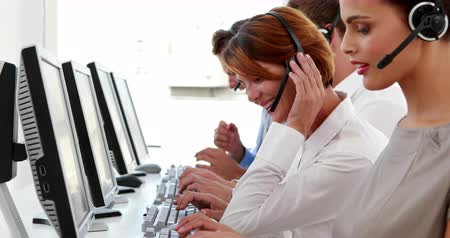сотрудники : Happy call center employees at work in the office