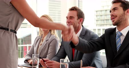 rozhovor : Interview panel shaking hands with applicant in the office