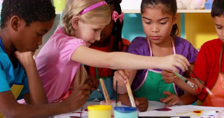 anaokulu : Preschool class painting at table in classroom in playschool Stok Video