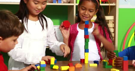 bloklar : Cute classmates playing with building blocks in playschool