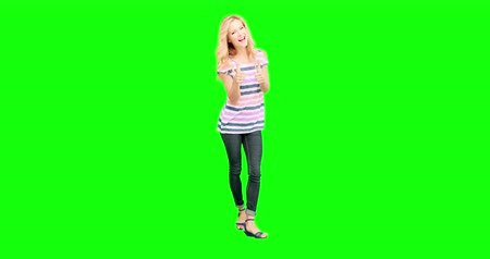 tenso : Pretty blonde smiling at camera on green screen background