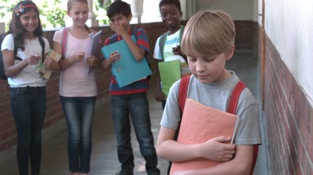 médio : Pupils bullying another in the hall in slow motion Stock Footage