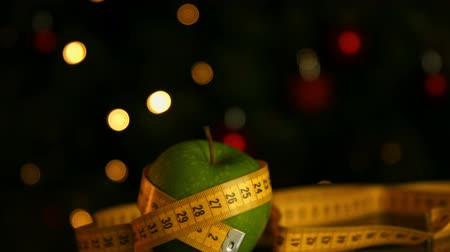 palce : Green apple wrapped in a measuring tape