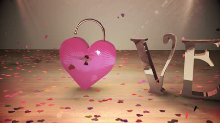 güvenli : Digital animation of Key opening a heart lock with golden love text Stok Video
