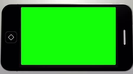 érintőképernyő : Digital animation of Hand using smartphone with green screen Stock mozgókép