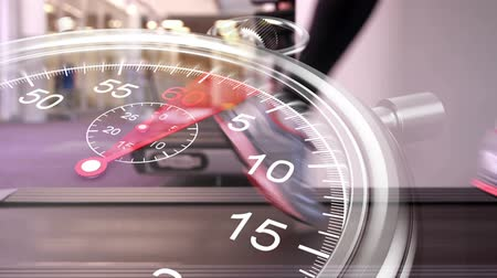 leisure time : Digital animation of Stopwatch graphic over runner on treadmill Stock Footage
