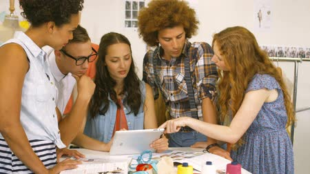 using tablet : Fashion students having a meeting together in high quality 4k format Stock Footage