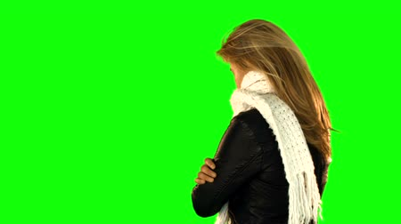başörtüsü : Shivering pretty woman with winter clothes on green screen background in ultra hd format