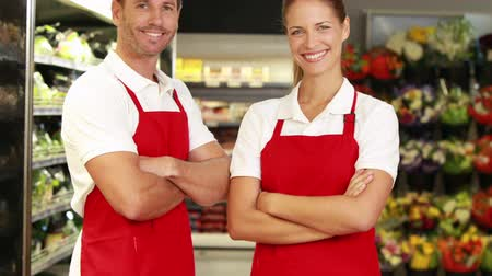 grocery : Grocery store staff smiling at camera  Stock Footage