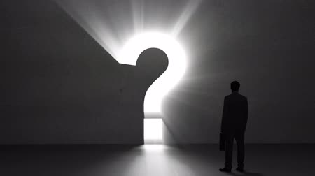sorular : Digital animation of Businessman looking at giant question mark