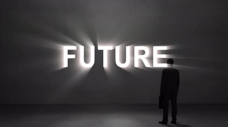 keresik : Digital animation of Businessman looking at giant future text Stock mozgókép