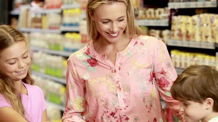 grocery : Happy mother shopping with children in grocery store Stock Footage