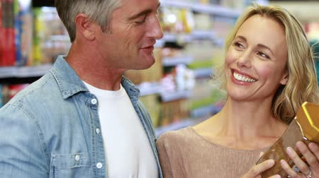 grocery : Portrait of happy couple shopping in grocery store