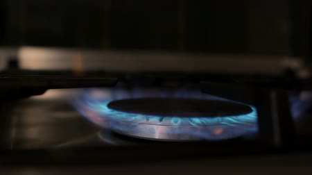 gas : Gas stove with flame turning on in slow motion Stock Footage