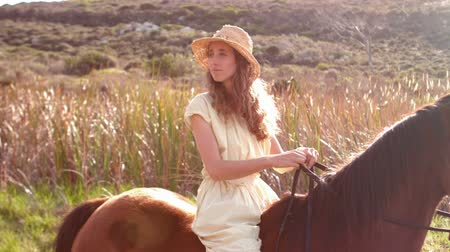 horse riding : Pretty woman sitting on a horse in slow-motion Stock Footage