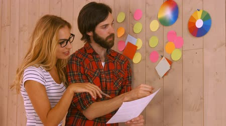 it's cool : Casual designers working on a post its wall at the office Stock Footage