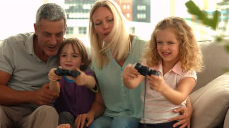 family life : Happy family playing video games in ultra hd format