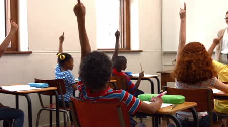 középiskola : School children raising hands in class in ultra hd format