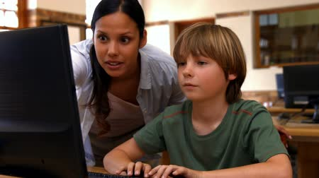sınıf : Pupil and teacher in computer class at school in ultra hd format