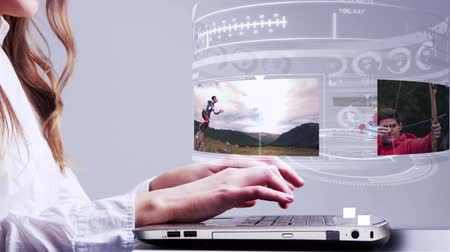 okçuluk : Digital animation of Woman using laptop with oudoor adventure hologram interface