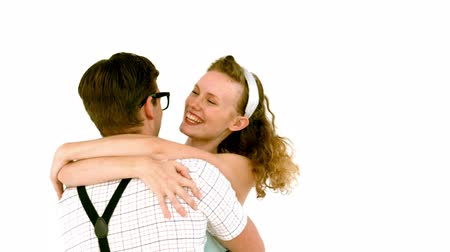 объятие : In slow motion geeky hipster couple hugging on white background Стоковые видеозаписи