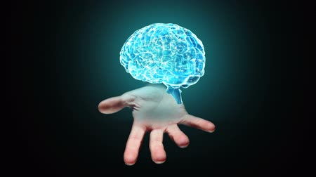 Digital animation of Hand presenting a spinning brain Stock Footage