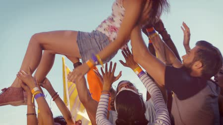 tłum : In high quality format happy hipster woman crowd surfing at a music festival Wideo