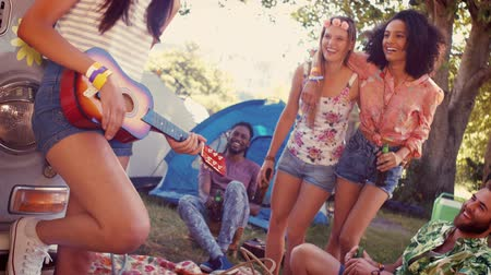 kamp : In high quality format hipsters having fun in their campsite at a music festival
