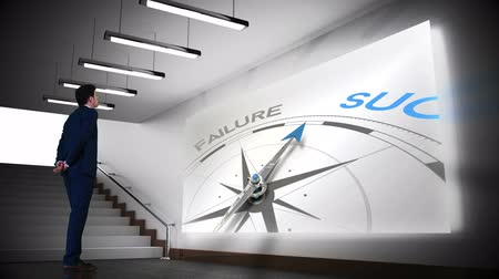 sucesso : Digital animation of Businessman viewing success compass clip