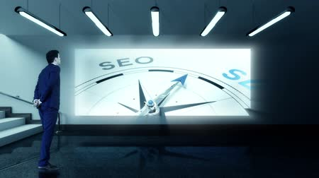 seo : Digital animation of Businessman viewing seo compass clip Stock Footage