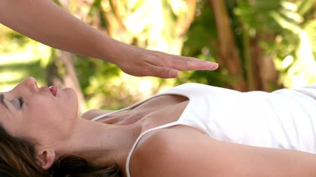 eyes closed : Calm woman receiving reiki treatment in slow motion Stock Footage