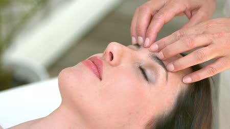 serene : Calm woman receiving reiki treatment in slow motion Stock Footage
