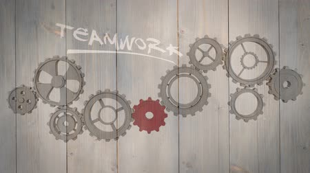 fa háttér : Digital animation of Cogs and wheels turning on wooden background