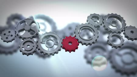 gray background : Digital animation of Cogs and wheels turning