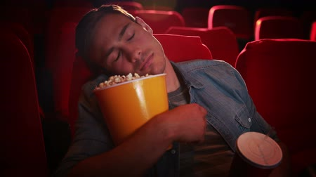 unott : Young man asleep at the cinema