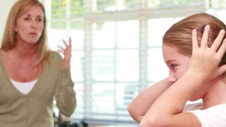 rude : Upset mother scolding her daughter at home