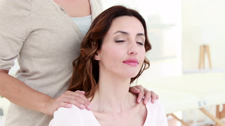 eyes closed : Woman getting reiki therapy on white background Stock Footage