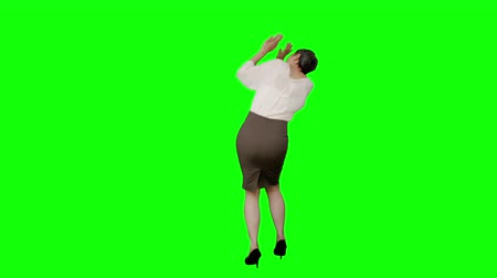 susto : Businesswoman standing with arms raised on green screen background