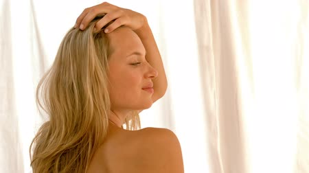 towel : Beautiful blonde relaxing on bed in a healthy spa