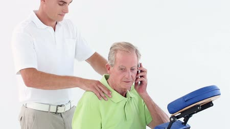 omuzlar : Doctor massaging his patients shoulders while he calling in medical office