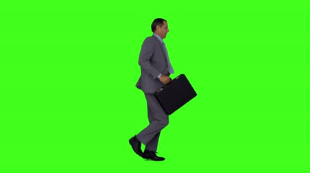 running man : Businessman running with his briefcase on green screen background