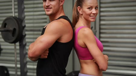 fit : Couple posing at crossfit gym in high quality  Stock Footage