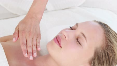 serene : Calm woman receiving reiki treatment  Stock Footage