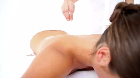 sůl : Pretty woman enjoying a salt scrub massage in slow motion Dostupné videozáznamy