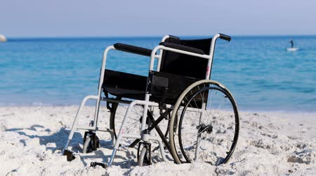 rokkant : Black wheelchair on the beach