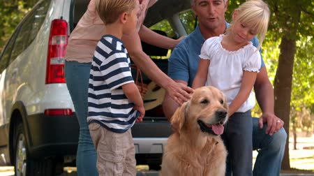 holidays : Happy family with their dog in the park on a sunny day