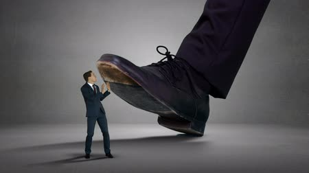 gigante : Digitally generated of shoes of giant boss trying to squash his employee