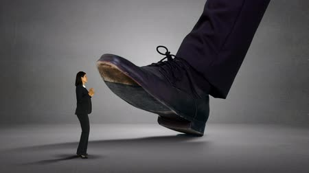 gigante : Digitally generated of shoes of giant boss trying to squash businesswoman