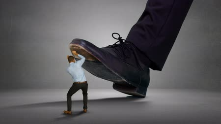 gigante : Digitally generated of shoes of giant boss trying to squash his scared employee