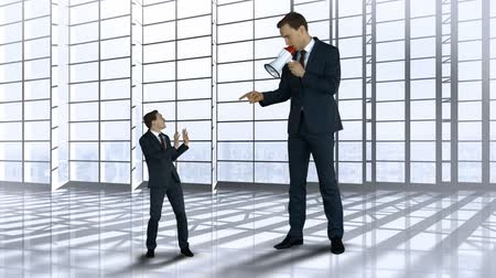 small businessman : Digitally generated of giant boss yelling on scared businessman with megaphone